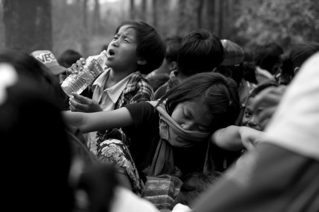 From November 2013: Kachin villagers including children flee for safety as the war intensifies. (PHOTO:  Lee Yu Kyung)