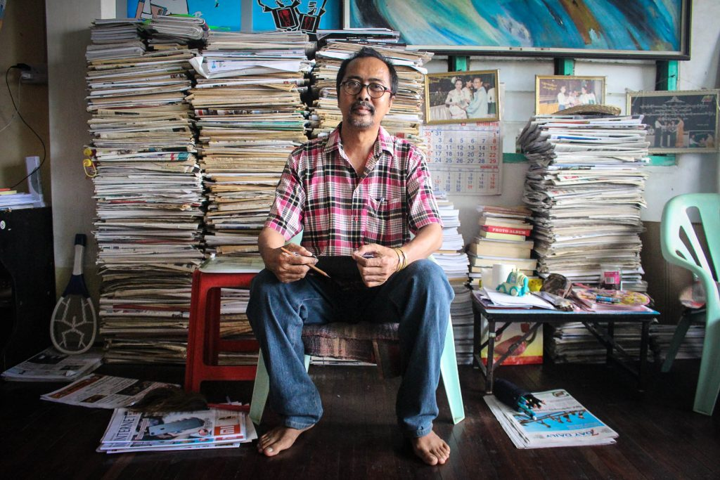 Political Cartoonist Soe Thaw Dar at home in his studio. (Photo: Libby Hogan / DVB)